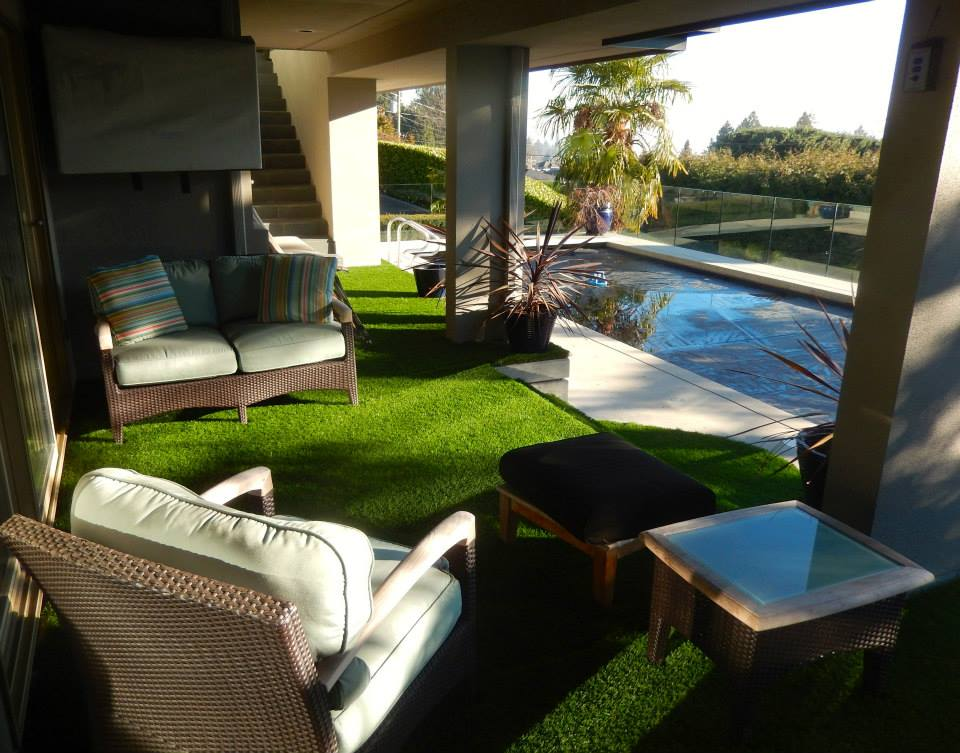 Lower deck with synthetic grass to pool area