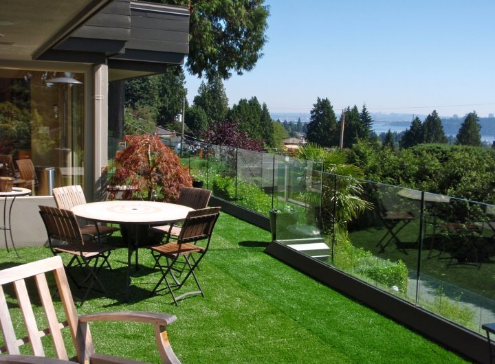 Decking can look like an extension of your yard with synthetic grass