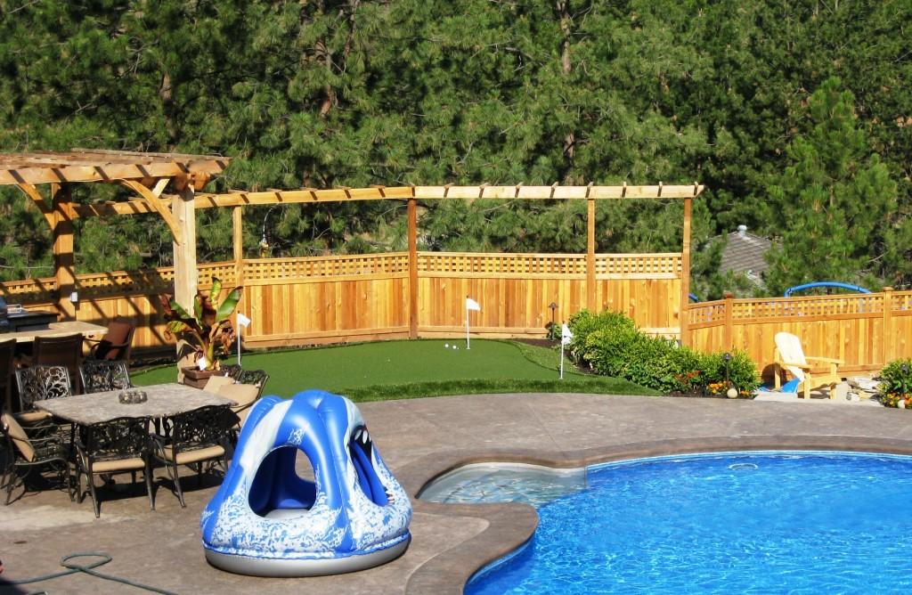 Putting green, poolside and playground all surrounded by synthetic grass for ease.